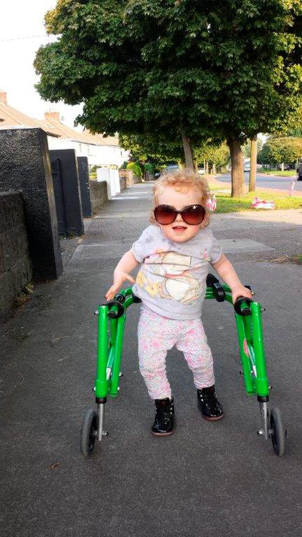 Ella styling some cool sunglasses (aged 2)