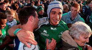 Ultan Dillane, right, and Robbie Henshaw embrace as they and Connacht fans celebrate Saturday's win over Glasgow. Photo: Ramsey Cardy/Sportsfile