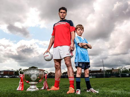 Bernard Brogan with Dublin fan Garbhan O Donaill (7) at the launch of SuperValu's 2016 'Kits for Kids' initiative. Photo: Dan Sheridan/INPHO