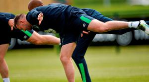 Aiden McGeady warms up during training in Abbotstown. Photo: David Maher/Sportsfile