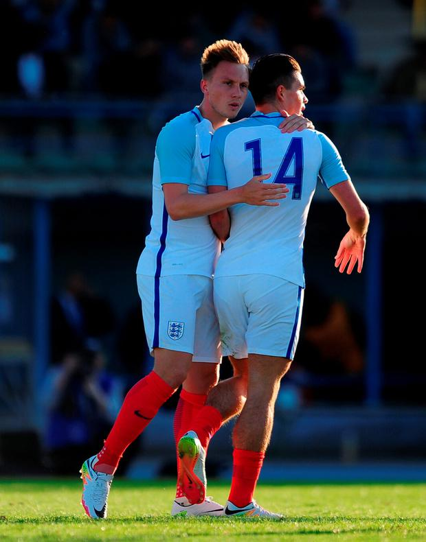 Jack Grealish of England (R) celebrates his sides first goal during the Toulon Tournament match between England and Guinea