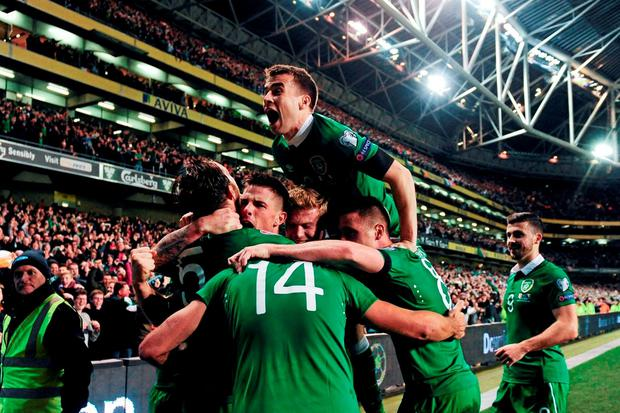 Jonathan Walters is mobbed by team-mates after scoring a crucial goal against Bosnia and Herzegovinia in the play-offs for Euro 2016. Photo: Sportsfile