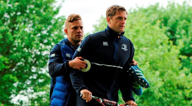 Ian Madigan and Jamie Heaslip make their way to Leinster's training session at Belfield yesterday on a scooter. Photo: Seb Daly/Sportsfile