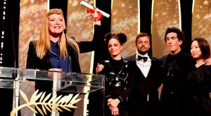 British director Andrea Arnold (L) celebrates on stage with (L-R) actress Sasha Lane, producer Lars Knudsen and Robbie Ryan after being awarded with the Jury Prize for the film 'American Honey' during the closing ceremony of the annual 69th Cannes Film Festival at Palais des Festivals in Cannes, France. (Photo by Pascal Le Segretain/Getty Images)