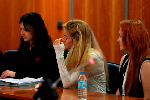 Maria Kukucova (centre) appears in court in Malaga, Spain, where she is accused of killing her former partner, British millionaire Andrew Bush. Photo: PA