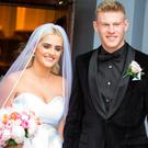 James McClean and wife Erin as they leave the church in Derry. Picture: North West Newspix