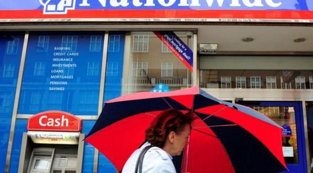 A woman passes a branch of the Nationwide Building Society in London May 27, 2009. REUTERS/Toby Melville