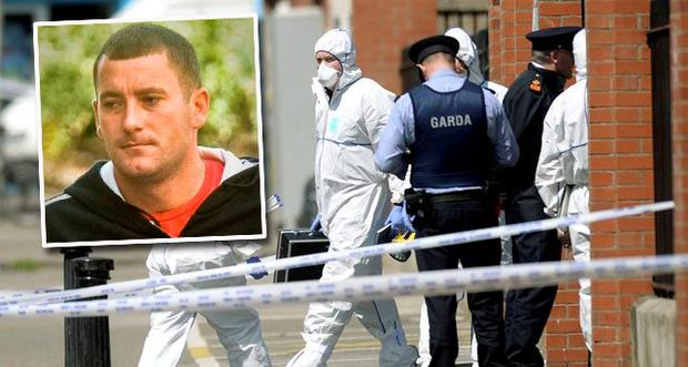 Gardai investigating the murder of Gareth Hutch raided a house in the north inner city (Inset: Murder victim Gareth Hutch)