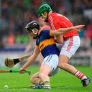 Cork's designated 'sweeper' for the day William Egan tussles with John McGrath of Tipperary during Sunday's Munster SHC quarter-final in Semple Stadium. STEPHEN McCARTHY / SPORTSFILE