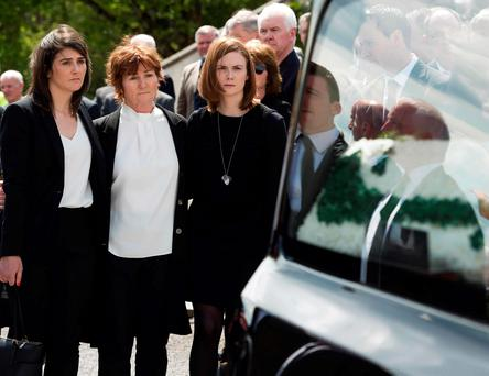 The family of former GAA president Joe McDonagh, daughter Muireann, wife Peig and daughter Eilís at his funeral in Bearna, Co Galway Photo:Andrew Downes, xposure