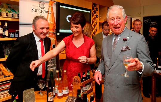 Prince Charles meets cider maker Catherine McKeever in Portadown yesterday Picture: Niall Carson/PA Wire