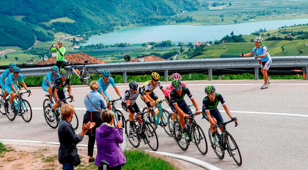The peloton rides during the 16th stage of the 99th Giro d'Italia, Tour of Italy, from Bressanone / Brixen to Andalo. Dutchman Steven Kruijswijk moved closer to a history-making Giro d'Italia triumph Tuesday after stretching his lead over Esteban Chaves and Vincenzo Nibali in a thrilling 16th stage won by Alejandro Valverde. GETTY