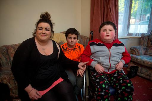 Shelley Walsh with her 10-year-old twin sons Damien and Brandon, who has muscular dystrophy Photo: Arthur Carron