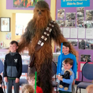 Star Wars character Chewbacca visits Scoil Baile an Fheirtearaigh in Kerry Picture: Garret Daly