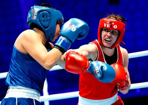 Ireland's Katie Taylor lands a punch on Victoria Torres of Mexico during her victory in Astana yesterday INPHO