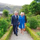Prince of Wales Charles and Duchess of Cornwall Camilla pictured as they stroll through the walled garden at Glenveagh Castle. Picture Credit: Frank Mc Grath