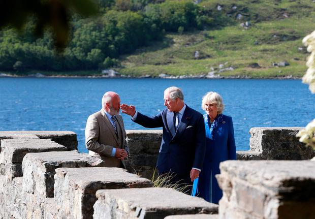 Prince of Wales Charles and Duchess of Cornwall, Camilla pictured with Dave Duggan, Divisional Manager Parks and Wild life Services , on the roof of the Boat house at Glenveagh Castle. Picture Credit: Frank Mc Grath