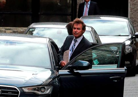 Alan Shatter leaves Leinster House after resigning as Justice Minister in May 2014. Photo: Arthur Carron