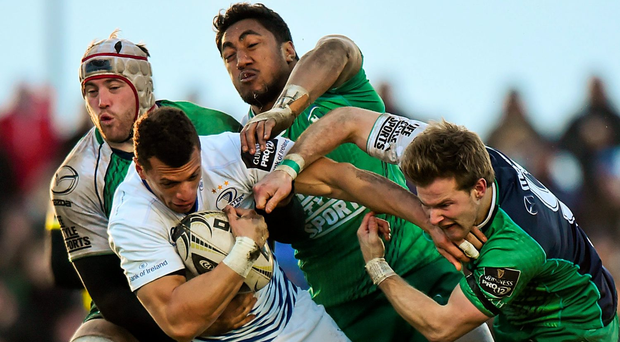 Leinster's Zane Kirchner is tackled by Eoin McKeon, Bundee Aki and Kieran Marmion back in March – an encounter that Connacht won 7-6: Ramsey Cardy / SPORTSFILE