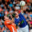 Stefan Campbell of Armagh and Cavan's James McEnroe battle for a high ball in 2014 – a game which the Orchard men won by six points (SPORTSFILE)