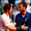 Andy Murray consoles the defeated Mathias Bourgue following the Men's Singles second round match on day four of the 2016 French Open (Getty Images)