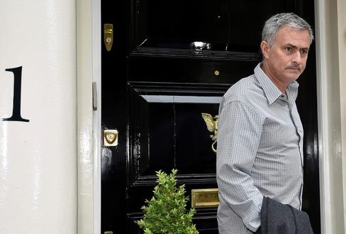 Jose Mourinho leaves his house in London yesterday. He is poised to be named as Manchester United manager today: REUTERS/Toby Melville