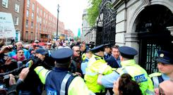 Water protesters shout at former Environment Minister Alan Kelly as he enters Leinster House last night. Photo: Rolling News