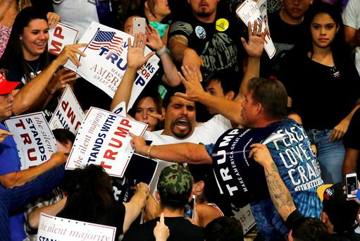 A protester disrupts a Donald Trump rally in Albuquerque, New Mexico. Photo: Reuters/Jonathan Ernst
