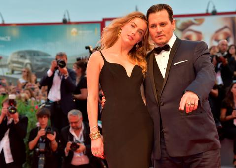 US actor Johnny Depp and his wife US actress Amber Heard arrive for screening of the movie