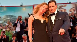 """US actor Johnny Depp and his wife US actress Amber Heard arrive for screening of the movie """"Black Mass"""" presented out of competition at the 72nd Venice International Film Festival"""