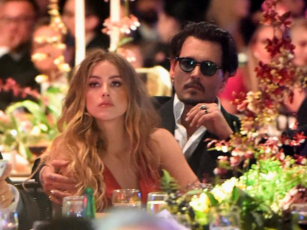 Actors Amber Heard and Johnny Depp attend The Art of Elysium 2016 HEAVEN Gala presented by Vivienne Westwood & Andreas Kronthaler at 3LABS on January 9, 2016 in Culver City, California. (Photo by Jason Merritt/Getty Images for Art of Elysium)