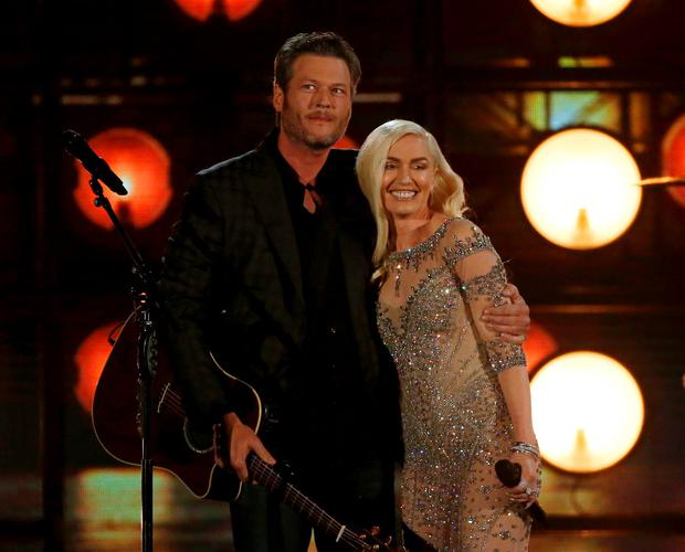 Blake Shelton and Gwen Stefani embrace after performing