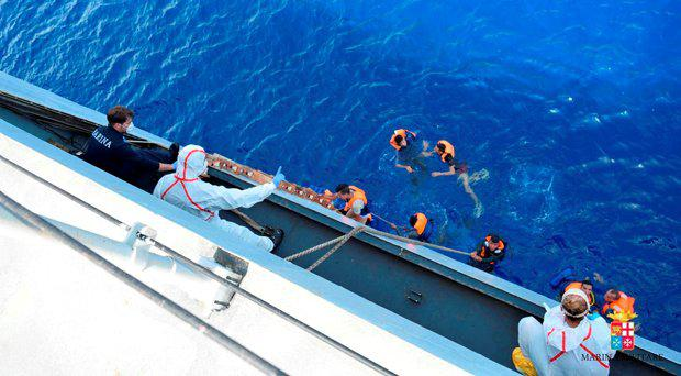 People are helped to board an Italian Navy ship after a boat overturned off the Libyan coast, Wednesday, May 25, 2016. File picture