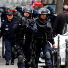 Special intervention French gendarmes and police leave the scene after an operation in Paris, France, May 26, 2016