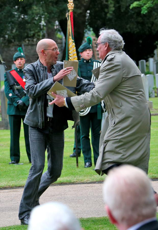 Kevin Vickers Ambassador of Canada to Ireland tackles a protestor who attempted to disrupt proceedings during a State ceremony to remember the British soldiers who died during the Easter Rising, 1916 pictured this morning at Grangegorman Military Cemetery.Picture Colin Keegan, Collins Dublin.
