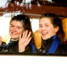 Aoife Nolan and Ruth Ryan waving from the bus as they depart from the school. Picture Colm Mahady / Fennells