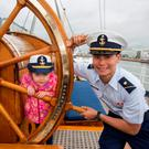 Caoimhe Kelly (3), from Clondalkin, Dublin, with US Coast Guard cadet Chris Nadeau on the Cutter Eagle tall ship which is docked in Dublin. Photo: Mark Condren