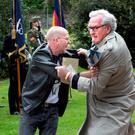 Canadian Ambassador to Ireland Kevin Vickers intercepts a protester at a State ceremony marking the deaths of British soldiers during 1916. Photo: Tony Gavin