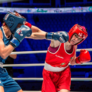 Kellie Harrington lands a punch on her way to beating Canada's Sara Cali in their light-welterweight semi-final at the Women's World Championships in Astana, Kazakhstan. Photo: AIBA via SPORTSFILE