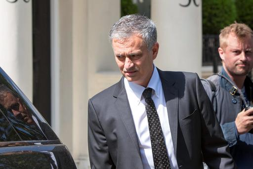 Jose Mourinho leaves his house in a car in London yesterday. Photo: Rick Findler/PA Wire