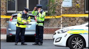 Gardaí at the scene of the fatal shooting of Gareth Hutch in Dublin city centre on Tuesday. Photo: Steve Humphreys
