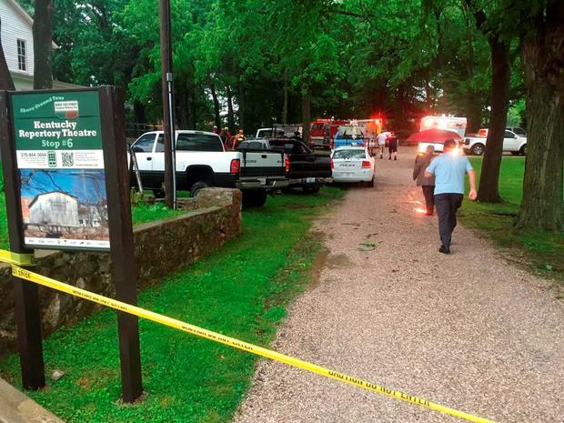 Officials stand on the scene after over a dozen people who exploring Hidden River Cave were trapped by rising water Thursday, May 26, 2016, in Horse Cave, Ky. Horse Cave Fire Chief Donnie Parker said the rising water was caused by heavy rains in the area Thursday afternoon. (Austin Anthony/Daily News via AP)