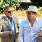 Actors Brad Pitt and George Clooney arrive for the 'Burn After Reading' Photocall part of the 65th Venice Film Festival