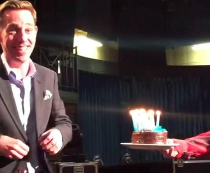 Ryan Tubridy gets cake from his colleagues during Facebook live video