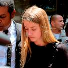 Actress Amber Heard leaves Los Angeles Superior Court court. Photo: AP Photo/Richard Vogel