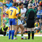 Paul Galvin knocks referee Paddy Russell's notebook to the ground before being sent off in 2008 (SPORTSFILE)