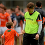 Kieran McGeeney and his son Cian at the end of Armagh's Championship game against Wicklow last summer - Armagh are outsiders to win against Cavan tomorrow Picture credit: Piaras Ó Mídheach / SPORTSFILE