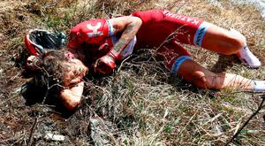 Russia's Ilnur Zakarin lies in a ditch after crashing during the Colle dell'Agnello downhill on stage 19 of the Giro d'Italia (Getty Images)