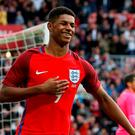 Marcus Rashford celebrates after scoring the first goal for England Action Images via Reuters / Ed Sykes