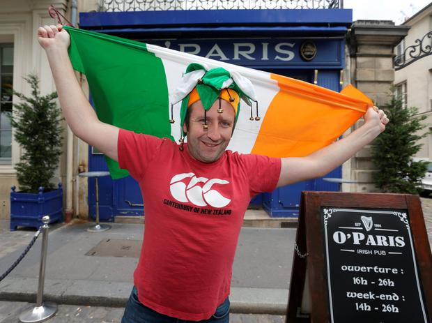 Arnaud Barre, bar manager at O'Paris pub in Versailles poses with the Irish flag. Picture: Damien Eagers